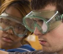 Two people wearing safety glasses