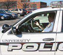 University Police vehicle with officer behind the wheel